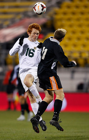 Medina's Ian Gummo goes up for a header against Beavercreek's Vincent Peden during the first half of the Division I State Championship game. (RON SCHWANE / GAZETTE)