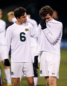 Medina's Riley Furey and Cole Werthmuller (6) walk off the field after losing to Beavercreek 1-0 in the second overtime of the Division I State Championship game. (RON SCHWANE / GAZETTE)