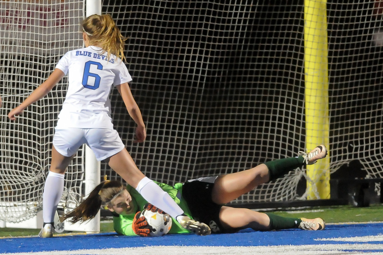 Medina goalie Emma Bulan makes a diving save in front of a charging Caylee Jozefov of Brunswick in the first half. JUDD SMERGLIA / GAZETTE