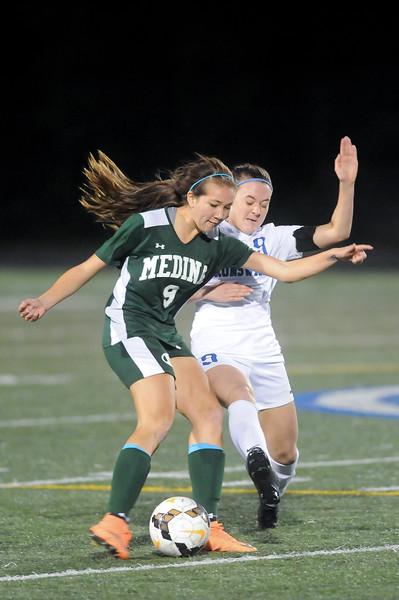 Brunswick's Heather Craska tries to block the shot of Medina's Lily Menssen in the first half.  JUDD SMERGLIA / GAZETTE