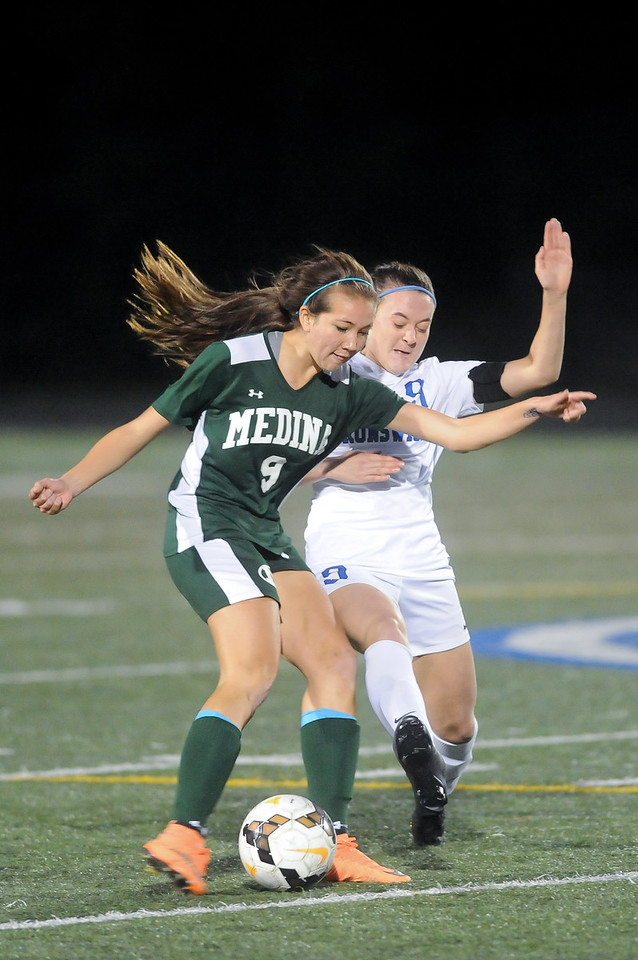 Brunswick's Heather Craska tries to block the shot of Medina's Lily Menssen in the first half.  JUDD SMERGLIA / GAZETTE