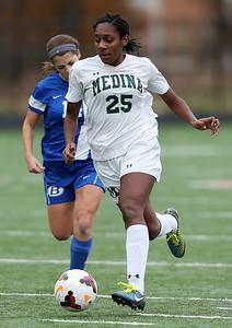 Medina's Janiece Joyner against Brunswick's Kristen Zima during the District championship game. (RON SCHWANE / GAZETTE)