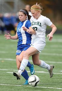 Medina's Tarah Roller battles Brunswick's Kristen Zima for the ball during the first half of the District championship game. (RON SCHWANE / GAZETTE)