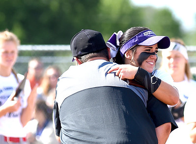 KRISTIN BAUER | CHRONICLE   Keystone High School shortstop Summer Constable hugs Coach Jim Piazza after she is announced as Mrs. Softball on Tuesday evening, June 7.