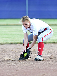 KRISTIN BAUER | CHRONICLE   Elyria High School shortstop Carly Bachna fields a ground ball during the Lorain County All Star softball game on Tuesday evening, June 7.