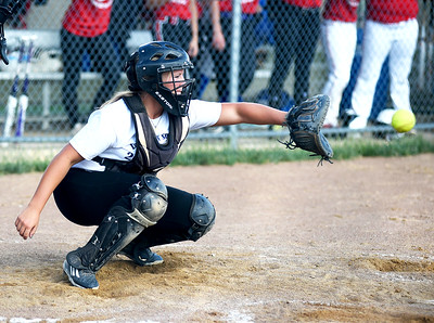 KRISTIN BAUER | CHRONICLE   Keystone High School's catcher Destiny Weber catches a pitch on Tuesday evening, June 7 during the Lorain County All Star softball game.