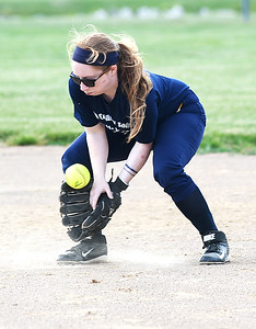 KRISTIN BAUER | CHRONICLE   North Ridgeville High School second baseman Megan Hokanson stops a ground ball on Tuesday evening, June 7 during the Lorain County All Star softball game.