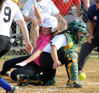 Carlee Grunda of the Pink team scores before the ball reaches the White team's Brooklynn Gonzales in the first inning Tuesday night at Wellington Community Park. STEVE MANHEIM/CHRONICLE