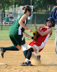 Amherst Jasmine Hromada is tagged out at second base by Medina Fire Rachael Solomon in third inning July 8.  Steve Manheim