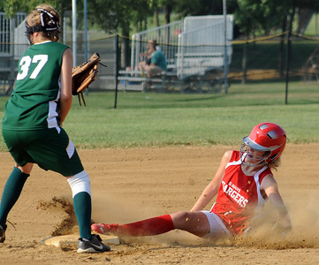 Amherst Ally Kanody steals second base before the throw to Medina Fire Rachael Solomon in first inning July 8. Steve Manheim