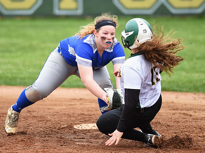 KRISTIN BAUER | CHRONICLE Midview High School shortstop Gabby Shackelford (17) tags Amherst Steele High School's Adrianna Marcano (15) out at second on Tuesday evening, April 4.