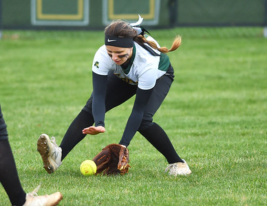 KRISTIN BAUER | CHRONICLE Amherst Steele High School center fielder Sarah Miller (10) fields a ground ball hit during a game against Midview High School on Tuesday aftenoon, April 4.