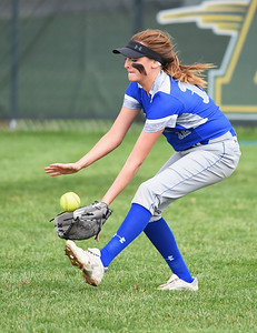 KRISTIN BAUER | CHRONICLE Midview High School right fielder Gabby Zerbini (12) fields a ground ball hit during a game against Amherst Steele High School on Tuesday evening, April 4.