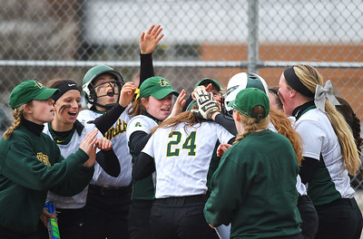 KRISTIN BAUER | CHRONICLE Amherst Steel High School's Lauren Kachure (24) is congratulated after hitting a home run hit against Midview High School on Tuesday aftenoon, April 4.
