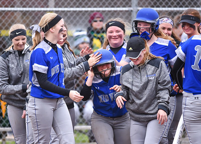 KRISTIN BAUER | CHRONICLE Midview High School's Hannah Taulbee (5) is congratulated after hitting a home run hit against Amherst on Tuesday evening, April 4.