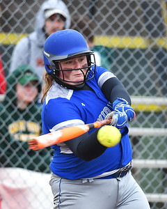 KRISTIN BAUER | CHRONICLE Midview High School's Faith Hamilton (32) bats against Amherst Steele High School on Tuesday evening, April 4.