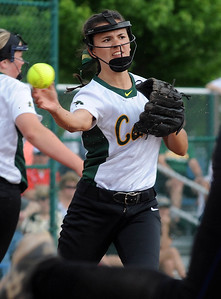 Amherst's Ashley Cogdell throws to first base in a regional semifinal May 25. STEVE MANHEIM/CHRONICLE