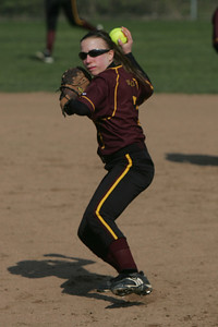 Avon Lake's #7 Megan Novotny fields an infield grounder and guns out the runner.  photo by Chuck Humel