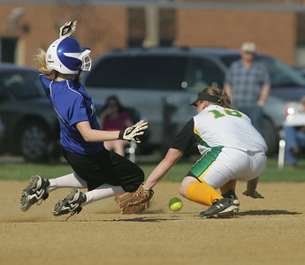 6APR10  Midviews Paige Stefancin steals second base; Amherst's Amanda Arendt scrambles for a low throw.  photo by Chuck Humel