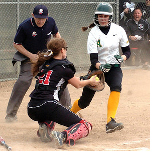 Amherst's #8 Ashlee Dahman tries to move around the tag of Perkins' catcher #21 Shannon Matso as she guards the plate.