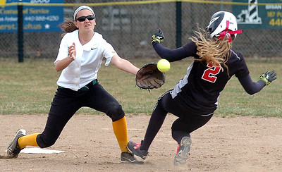 Amherst's #2 Ashley Cogdell waits for the ball as Perkins' #2 Corrine O'Hara spikes Ashley then slides into second.  Corrine was called safe.