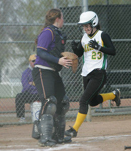 Amherst's #23 Jessica Moore crosses the plate uncontested.   photo by Chuck Humel