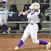Keystone's Autumn Acord hits a grand slam in the second inning Tuesday against Wellington. Acord has five home runs and two grand slams this season. STEVE MANHEIM / CHRONICLE