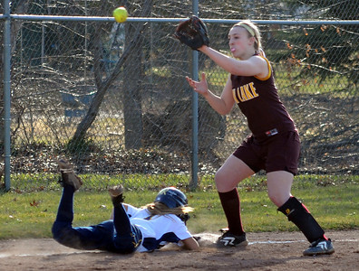 North Ridgeville Haley Gall returns safely back to third base in front of Avon Lake Kaity Mullen in fourth inning Mar. 31.   Steve Manheim