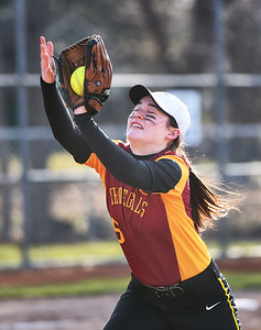 KRISTIN BAUER | CHRONICLE Avon Lake High School pitcher Lexi Anderson (5) catches a pop fly during a game against Avon High School on Wednesday evening, March 29.