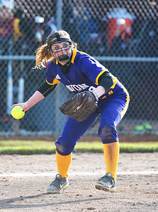 KRISTIN BAUER | CHRONICLE Avon High School third baseman Casey Traine (9) picks up a bunted ball and fires to first during a game against Avon Lake on Wednesday evening, March 29.