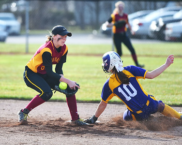 KRISTIN BAUER | CHRONICLE Avon High School junior Tina Clark (10) slides into second base before Avon Lake High School sophomore Liz Thieken (8) can tag her out on Wednesday evening, March 29.