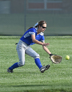 KRISTIN BAUER | CHRONICLE Midview High School center fielder Cassie Haight fields a ground ball in center during a game against Amherst on Wednesday evening, April 20.