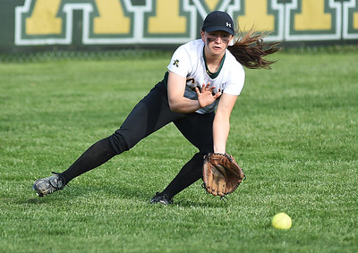 KRISTIN BAUER | CHRONICLE Amherst High School left fielder Sarah Miller (10) fields a ground ball during a game against Midview High School on Wednesday evening, April 20.