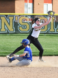 KRISTIN BAUER | CHRONICLE Amherst High School shortstop Kasey McGraw (9) catches a throw to second, but is too late to make the out as Midview High School's Hannah Taulbee (5) slides safely into second.