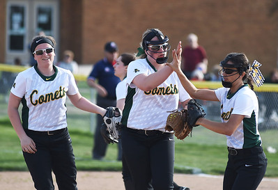 KRISTIN BAUER | CHRONICLE Amherst High School pitcher Lauren Kachure (24) (CENTER) high-fives shortstop Sarah Miller (10) (LEFT) and third baseman Ashley Cogdell (2) (RIGHT) after an out during their game against Midview.