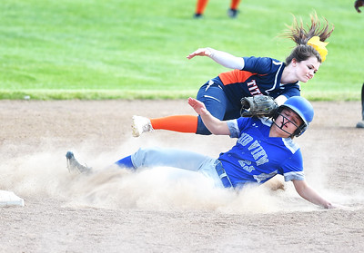 KRISTIN BAUER | CHRONICLE Midview High School's Autumn Brister (23) slides into second but is tagged out by Berea-Midpark High School shortstop Mikhayla Hale (6) on Wednesday afternoon, May 10.