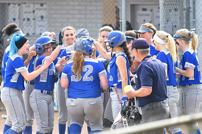 KRISTIN BAUER | CHRONICLE Midview high School's Faith Hamilton (32) is congratulated by her teammates after hitting a home run during a game against Berea-Midpark High School on Wednesday afternoon, May 10.