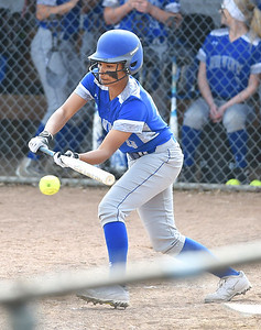 KRISTIN BAUER | CHRONICLE Midview High School's Kaeli Evins (13) bunts the ball to advance two runners and put them into scoring position during a game against Berea Midpark High School on Wednesday afternoon, May 10.