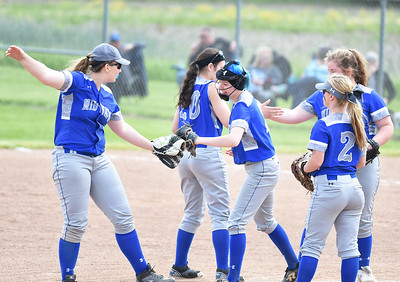 KRISTIN BAUER | CHRONICLE Midview High School pitcher Lauren Landers (3) is congratulated by teammates after a strike out against Berea-Midpark High School on Wednesday afternoon, May 10.
