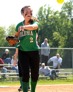 Columbia pitcher Jen Kus makes a put out throw to first base in sectional softball May 19.  Steve Manheim