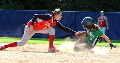 Columbia Jen Kus is tagged out on steal attempt by Loudonville Alexis Van Horn in sectional softball at North Ridgeville May 19.   Steve Manheim