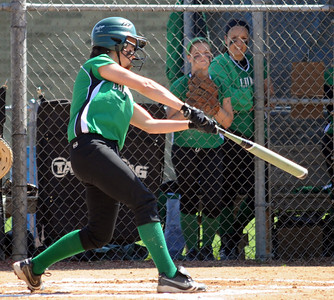 Columbia Jen Kus hits an RBI double in second inning of sectional softball May 19.  Steve Manheim