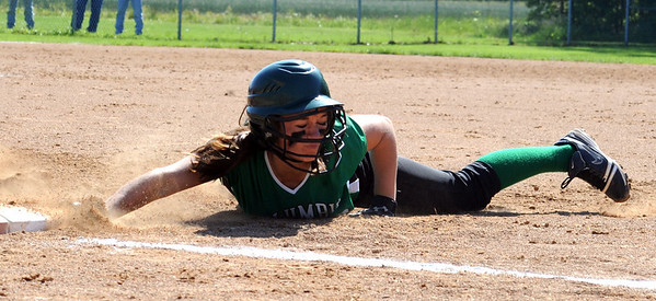 Columbia Jen Kus slides safe back into first base in sectional softball May 19.   Steve Manheim