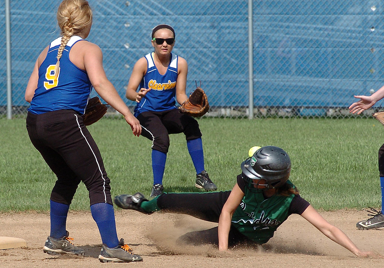 Columbia's #10 Crystall Fetchet slides safely into second as Clearview's #2 Katelyn Jones waits for the ball as #9 Rebecca Serfozo backs her up.