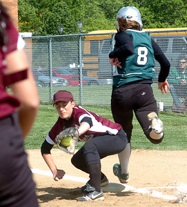 Top of 1st - EC's #8 Jasmin Filiaggi is safe at 1st as Wellington's #12 Rachel Cook waits for the ball.