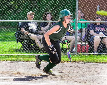 Elyria Catholic's Olivia Madera watches her hit  to deep right field which went for a double Thursday against Columbia in a Division III sectional semifinal at Avon Lake. EC won 10-3.  JOE COLON / CHRONICLE