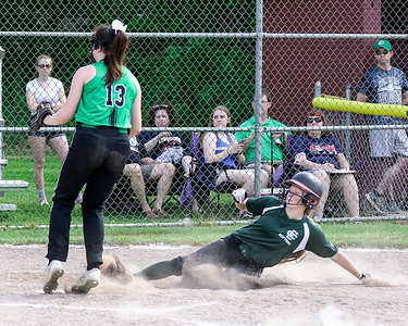 Elyria Catholic's Julia Allegretto slides safely at home on a passed ball as Columbia pitcher Riley Thomas covers the plate Thursday. JOE COLON / CHRONICLE