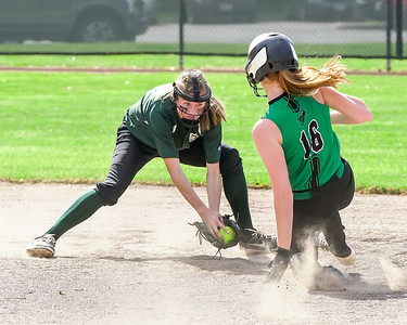 Elyria Catholic's Sam Filiaggi puts the tag on Columbia's Riley West in her attempt to steal second base Thursday, May 18. JOE COLON / CHRONICLE