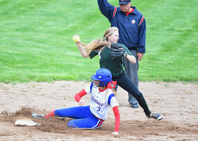 KRISTIN BAUER | CHRONICLE Elyria Catholic High School second baseman Julia Allegretto (00) attempts to turn a double play as Tuslaw High School's Molly McMerrell (3) is called out at second on Wednesday, May 24.