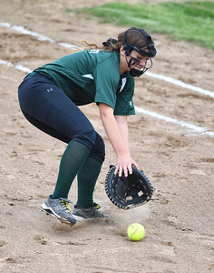 KRISTIN BAUER | CHRONICLE Elyria Catholic High School first baseman Bridgette Pronesti (10) charges a bunt hit during a game against Tuslaw on Wednesday afternoon, May 24.